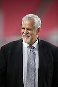 Former National Football League linebacker, former executive, and radio and television football commentator Matt Millen has a laugh with coaches before the Arizona Cardinals 2016 NFL preseason football game against the Oakland Raiders on Friday, Aug. 12, 2016 in Glendale, Ariz. The Raiders won the game 31-10. (©Paul Anthony Spinelli)