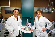 Dr. Gerald S. Watanabe and Dr. Nancy Ocampo Watanabe of Capitol Square Dental Care poses for a portrait at Capitol Square Dental Care in San Jose, California, on April 4, 2013.  The Watanabe's recently moved their separate practices into the same facility on McKee Road in San Jose. (Stan Olszewski/SOSKIphoto)