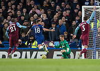 Football - 2019 / 2020 Premier League - Chelsea vs. West Ham United<br /> <br /> David Martin (West Ham United) blocks the effort from Olivier Giroud (Chelsea FC) at Stamford Bridge <br /> <br /> COLORSPORT/DANIEL BEARHAM