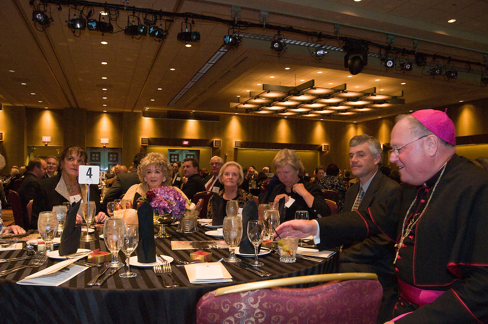 Guest sit down for dinner with Archbishop Dolan at the Annual Rectors Dinner at the Hyatt, in Milwaukee, Wisconsin on October 4, 2008.