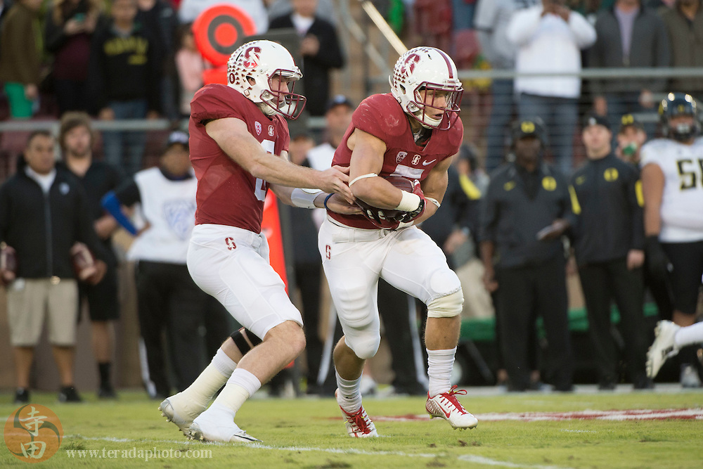 November 14, 2015; Stanford, CA, USA; Stanford Cardinal running back Christian McCaffrey (5, right) receives the hand off from quarterback Kevin Hogan (8) during the first quarter against the Oregon Ducks at Stanford Stadium.