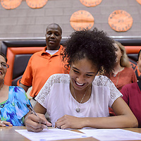 Ni'asia Mcintosh signs her letter of intent to play basketball for New Mexico Junior College at the Gallup High School gym in Gallup Friday.