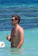 Dave Annable and Odette Yustman..Dave Annable drinking beer while swimming..Celebrities on the Beach while attending the Labor Day weekend in Puerto Rico for Hollywood Domino Celebrity Golf Tournament..Palomino Island, Puerto Rico, USA..Saturday, September 03, 2011..Photo By CelebrityVibe.com..To license this image please call (323) 325-4035; or .Email: CelebrityVibe@gmail.com ; .website: www.CelebrityVibe.com.**EXCLUSIVE**