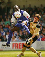 Photo:  Frances Leader.<br />Gillingham FC v Cardiff City FC. Coca Cola Championship. <br />Priestfield Stadium<br />30/04/05<br />Gillinghams Mamady Sidibe colides with Cardiff's goalie Neil Alexander as he tries to score a goal.