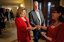 6th district congressional incumbent Karen Handel, and her husband, Steve, turning their voter cards to poll worker Laura Hefton, voted at the St Mary's Orthodox Church in Roswell. Photo by Bob Andres/Atlanta Journal-Constitution/TNS/ABACAPRESS.COM