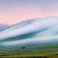 Misty Morning with fog clouds flowing down the moutains near cahersiveen, County Kerry, Ireland / ch231