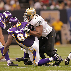 2008 October, 06: New Orleans Saints rookie offensive guard Carl Nicks (77) blocks Minnesota Vikings defensive tackle Pat Williams (94) during a week five regular season game between the Minnesota Vikings and the New Orleans Saints for Monday Night Football at the Louisiana Superdome in New Orleans, LA.