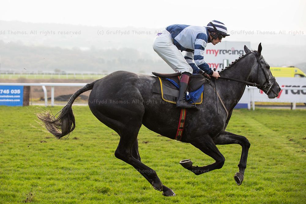 Ffos Las Racecourse, Trimsaran, Wales, UK. Friday 23 November 2018. Al Dancer (jockey Sam Twiston Davies) wins the Pennant Walters Novices' Hurdle (Race 2)