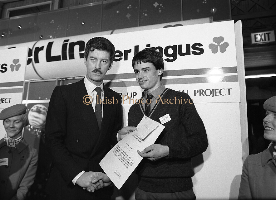 """Aer Lingus Young Scientist Exhibition..1986..10.01.1986..01.10.1986..10th January 1986..The annual Aer Lingus,sponsored,Young Scientists Exhibition was held at the RDS,Ballsbridge,Dublin.The Overall winners of the competition were Ms Breda Maguire and Ms Niamh Mulvany..They are students at The Rosary College,Raheny,Dublin. The Tanaiste, Mr Dick Spring TD was on hand to present the awards...Photograph of Shane Donovan,.Silverdale Road,Ballinlough,Cork being awarded the Runner-up Individual Award By Tanaiste Mr Dick Spring. Shane submitted a project called """"The quality of water in the aquifiers of the Cork regionwith reference to industrial development"""". Thisis Shane's third entry into the competition. Last year Shane won the """"Chemistry Association Of Ireland Award""""..This year as part of his prize,Shane, will be invited to attend the European Space Agency Base on the occasion of the space craft """"Giotto"""" meeting """"Halleys Comet""""."""