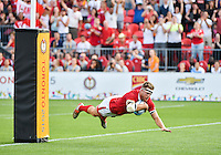 July 12, 2015: Conor Trainor (#5) of Team Canada scores a try in the gold medal match against Team Argentina in the Men's Rugby 7's at Exhibition Stadium during the Toronto 2015 Pan Am Games in Toronto, Canada.