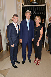 Left to right, US Ambassador MATTHEW BARZUN, US Secretary of State JOHN KERRY and MRS BROOKE BARZUN at a party to kick off London Fashion Week hosted by US Ambassador Matthew Barzun and Mrs Brooke Brown Barzun with Alexandra Shulman in association with J.Crew hrld at Winfield House, Regent's Park, London on 18th September 2015.