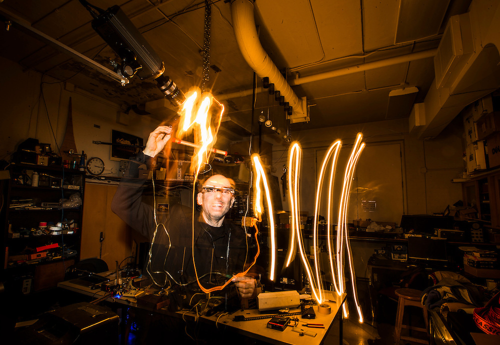 """Toronto, Ontario - May 4, 2015 -- Internet of things --  Professor Steve Mann demonstrate his """"Phenomenamplifier"""" invention in Toronto, Monday May 4, 2015.  The """"Phenomenamplifier"""" amplifies physical phenomena to drive light sources that makes invisible signals, visible. During this 30 second exposure on the camera surveilluminescence is see, where the lamp glows when it is seen by a surveillance camera, thus indicating the amount of surveillance present at each point in 3D space.    (Mark Blinch for the Globe and Mail)"""