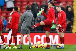 Liverpool's Virgil van Dijk (centre) playfully kicks assistant manager Zeljko Buvac before the Premier League match at Anfield, Liverpool.
