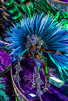 Samba dancer on a float of the Paraiso do Tuiuti samba school's carnaval parade in the Sambadrome, Rio de Janeiro, Brazil.
