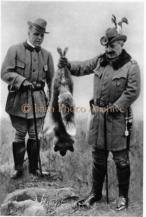 William II (1859-1941) Emperor of Germany from 1888-1919, right, holding up a hunting trophy. the other figure is Max Egon zu Furstenberg.