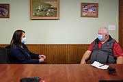 """14 OCTOBER 2020 - KNOXVILLE, IOWA: THERESA GREENFIELD, the Democratic candidate for US Senator from Iowa, (left) talks to MAX SMITH in the office at Smith Fertilizer and Grain. Greenfield toured Smith Fertilizer and Grain in Knoxville and talked to owner Max Smith about her """"Fair Shot for Our Farmers"""" plan to improve Iowa's farm economy. Greenfield is in a tight race with incumbent Republican Senator Joni Ernst.     PHOTO BY JACK KURTZ"""