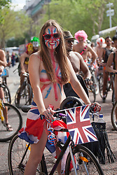 © licensed to London News Pictures. London, UK 09/06/2012. A cyclist with a union jack face and body paint posing on her bike as cyclists having a naked bike ride in London to raise awareness of the need for more tolerance of bicycles on the road in the city. Photo credit: Tolga Akmen/LNP