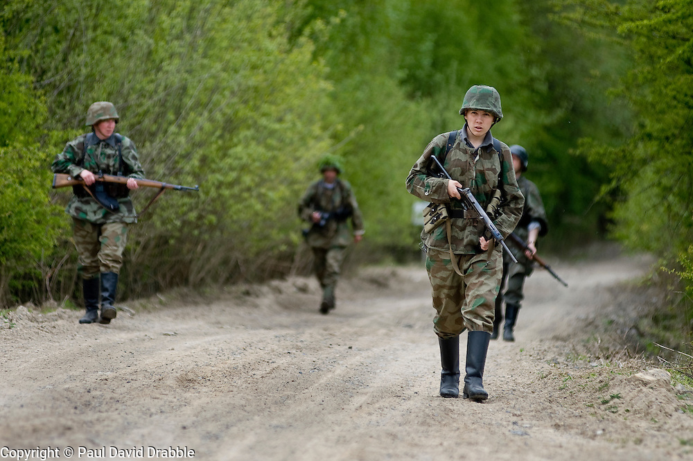 A reenactors from Northern World War Two Association, dressed as elements of the Elite Gross Deutschland Division advance along a dirt road during a private 24hr excerise, held at Sutton Grange, near Ripon in Yorkshire 15  May 2010 .Images © Paul David Drabble.