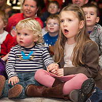 Rhona O'Malley and her brother Evan from O'Briens Bridge watching the puppet show before boarding their Santa flight