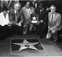 1984 Sidney Poitier holds the plaque during Dorothy Dandridge's posthumous Walk of Fame ceremony