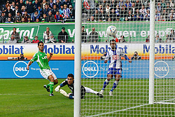29.10.2011,Volkswagen Arena, Wolfsburg, GER, 1.FBL, VFL Wolfsburg vs Hertha BSC Berlin, im Bild  Raffael (Berlin #10) trifft zum 1 zu 0 Torwart Diego Benaglio (Torwart Wolfsburg) liegt am boden .// during the match from GER, 1.FBL,VFL Wolfsburg vs Hertha BSC Berlin  on 2011/10/29, Volkswagen Arena, Wolfsburg, Germany..EXPA Pictures © 2011, PhotoCredit: EXPA/ nph/  Schrader       ****** out of GER / CRO  / BEL ******