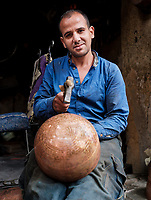 FEZ, MOROCCO - CIRCA MAY 2018: Portrait of Moroccan metal worker at the Medina in Fez. Fes el Bali. is the oldest walled part of Fez, Morocco.