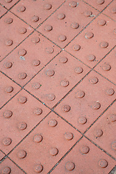 Tactile paving which enables blind people to know they have reached the pavement edge.