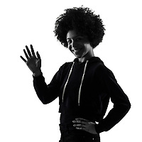 one mixed race african young teenager girl woman salute saluting in studio shadow silhouette isolated on white background