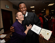Atlanta: Druid Hills High School teacher, Alissa Montooth, gets a hug from Brandon Lamar Rogers after graduation at the Atlanta Civic Center on Friday, March 24,2013. She is the teacher of the year for DeKalb County School. © 2013 JOHNNY CRAWFORD