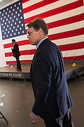 Former Texas Governor and GOP presidential hopeful Rick Perry waits to go onstage for a town hall campaign event aboard the USS Yorktown in Mount Pleasant, South Carolina.
