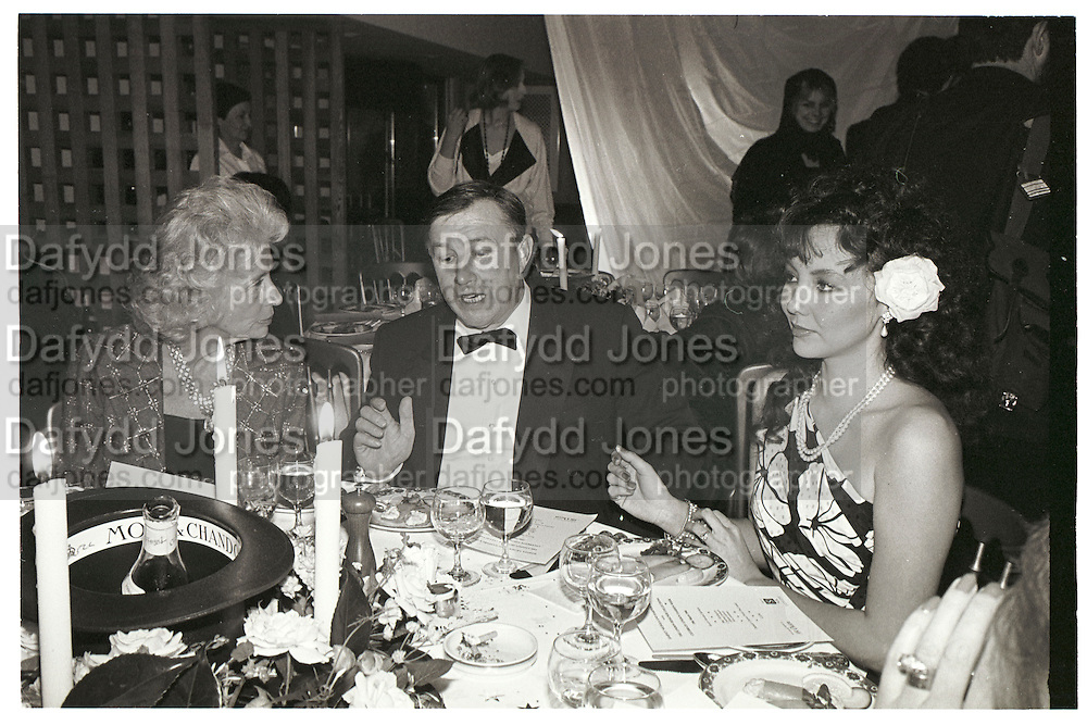 Sir Terence Conran; Marie Helvin. LDC party. Harvey Nicholls. London. 19 March 1984. SUPPLIED FOR ONE-TIME USE ONLY> DO NOT ARCHIVE. © Copyright Photograph by Dafydd Jones 248 Clapham Rd. London sW9 0PZ. 0207 820 0771.  www.dafjones.com