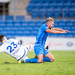 BRISBANE, AUSTRALIA - SEPTEMBER 20: Justyn McKay of Gold Coast City is fouled by Matthew Foschini of South Melbourne during the Westfield FFA Cup Quarter Final match between Gold Coast City and South Melbourne on September 20, 2017 in Brisbane, Australia. (Photo by Gold Coast City FC / Patrick Kearney)