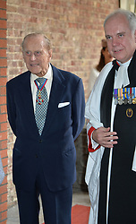 The Duke of Edinburgh leaving with Revd Canon Paul Wright at Chapel Royal in St James's Palace, London, after an Order of Merit service.