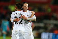 Gylfi Sigurdsson of Swansea city ® and teammate Angel Rangel celebrate at the end of the match. Premier league match, Swansea city v Southampton at the Liberty Stadium in Swansea, South Wales on Tuesday 31st January 2017.<br /> pic by  Andrew Orchard, Andrew Orchard sports photography.