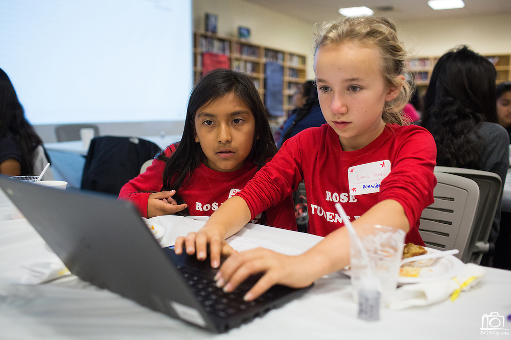 Rose fifth grader America Irineo, left, and sixth grader Gina Huss lock in their Jack Emery Drive goals with other MUSD schools during the Jack Emery Drive Brunch at Milpitas High School in Milpitas, California, on November 3, 2015. (Stan Olszewski/SOSKIphoto)