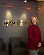 Nova Partners, Inc. associates pose for a portrait at the corporate office in Palo Alto, California, on November 7, 2014. (Stan Olszewski/SOSKIphoto)