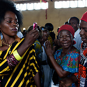 October 11th 2013, women cheer and sing in a local Christian Church in the district of Combattant in Bangui.