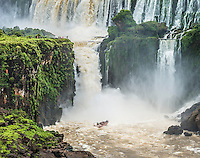 A boat sails tourists under the waterfalls to give them a real soaking.