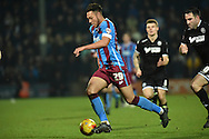 Kyle Wootton of Scunthorpe United  makes his way up the field during the Sky Bet League 1 match between Scunthorpe United and Wigan Athletic at Glanford Park, Scunthorpe, England on 2 January 2016. Photo by Ian Lyall.