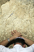 A religious Jew praying at the Western ('Wailing') Wall, Jerusalem, Israel