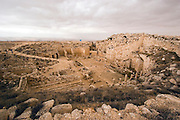 Herod the Great built Herodium (or Herodion) c. 24 BCE as both a palace and a fortress.  The Herodium sat on the flattened top of a hill that rises c. 400 feet above the surrounding terrain. The roof and upper stories of the Herodium no longer exist; the remains of four towers, however, are still visible. Situated in the Judean Hills between Jerusalem and Hebron, about 20 kms south of Jerusalem. On the route followed by our patriarchs Abraham, Issac and Jacob as mentioned in the book of Genesis. King David lived and fought in this area and Elazar the Maccabee fell in battle in the valley
