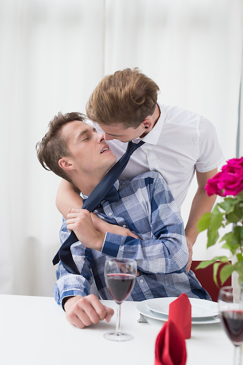 Homosexual couple kissing each other