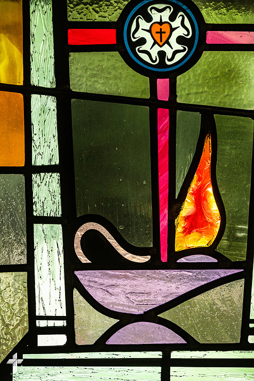 Stained glass depicting the lamp of learning from Jesus revealing his wisdom to the elders in the temple (Matthew 2:13-15, Luke 2:41-52) and symbolizing the Biblical teaching of The Lutheran Church—Missouri Synod, on Sunday, Aug. 2, 2020, at Elm Grove Lutheran Church, Elm Grove, Wis. LCMS Communications/Erik M. Lunsford