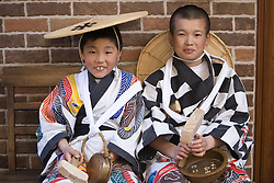 Asia, Japan, Gifu prefecture, Takayama (also known as Hida-Takayama), boys in traditional robes and hats during Sanno Festival of Hie Jinja Shrine, held annually in April.