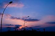 India, Himachal Pradesh, Manali, Vashisht silhouette of people at sunset