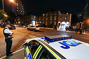 """Police secured the Stockwell Road, waiting for a forensic unit to arrive at the crime scene in South London on Tuesday, Sept 15, 2020 - after a man, aged 20, was stabbed to death in Lambeth. Police said that """"despite the best efforts of paramedics, he was pronounced dead at the scene.' (VXP Photo/ Vudi Xhymshiti)"""