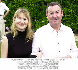 Musician NICK MASON and his daughter MISS CHLOE MASON at a luncheon in West Sussex on 8th July 2001.	ORA 99