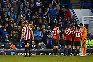 Sunderland Defender, Glenn Loovens (4) shown a red card during the EFL Sky Bet League 1 match between Portsmouth and Sunderland at Fratton Park, Portsmouth, England on 22 December 2018.