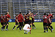 13 December 2015: Stanford players celebrate at the end of the game while Clemson's Iman Mafi (NOR) (7) kneels to the ground. The Clemson University Tigers played the Stanford University Cardinal at Sporting Park in Kansas City, Kansas in the 2015 NCAA Division I Men's College Cup championship match. Stanford won the game 4-0.