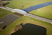 Nederland, Gelderland, Westervoort, 23-01-2006; spoorbrug over de rivier de IJssel, personentrein Syntus passeert goederentrein;.de spoorlijn verbindt Arnhem met Zevenaaar en Emmerich; IJsseldal met uiterwaarden; binnenvaart, binnenvaartschepen, brug, vakwerk, ijzer..luchtfoto (toeslag); aerial photo (additional fee required); .foto Siebe Swart / photo Siebe Swart
